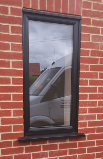 Black foiled upvc window fitted in Norfolk