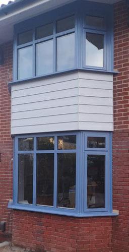 blue aluminium windows fitted in Norfolk