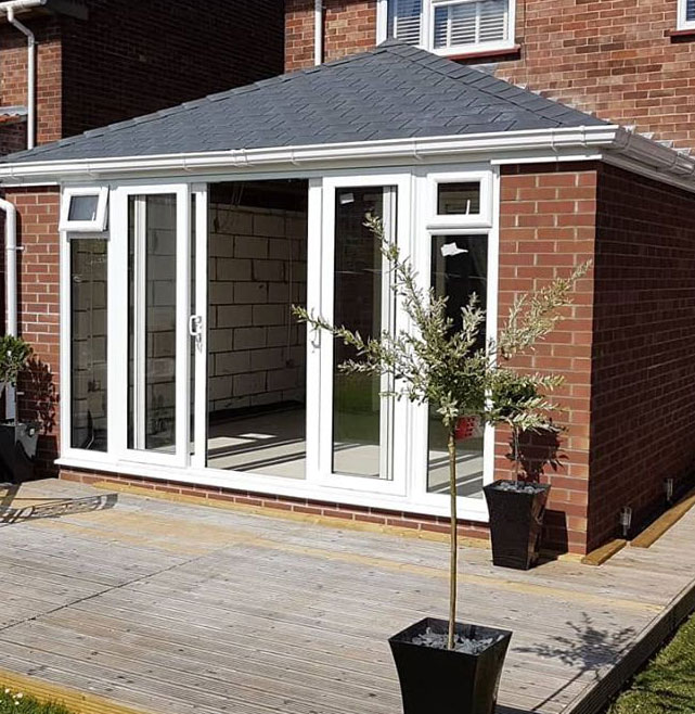 warm roof on conservatory with upvc sliding doors